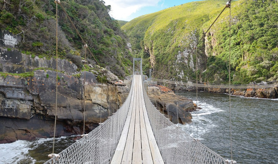 The suspension bridge across the Storms River Mouth in Tsitsikamma on the Garden route in South Africa